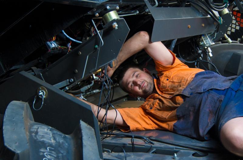 Agg-Tech Machinery mechanic working on a vehicle.