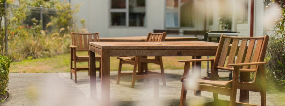 Te Hopai Home and Hospital outdoor patio area with wood furniture