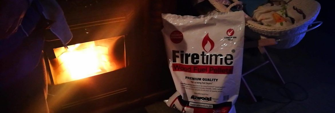 azwood energy fireplace with a bag of product next to it.